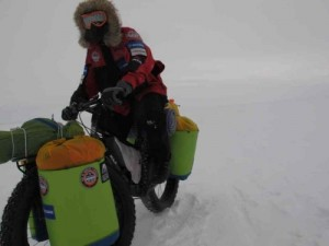 Eric Larsen riding bike in Antarctica