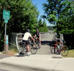 Bicyclists come and go over I-90 ped bridge in Bellevue