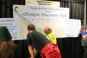 Checking out Olympic Discovery Trail maps at Seattle Bike Expo