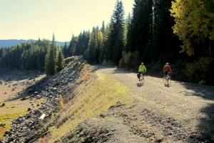 Cyclists ride along the nearly dry Keechelus lake bed in the fall.