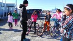 Clara Hughes talks with young cyclists