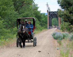 A wagon heads east after crossing Yakima River trestle.