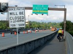 Cyclists pass construction zone Monday morning...