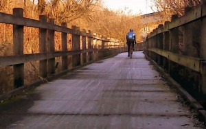 A cyclist on Mercer Slough causeway in the winter