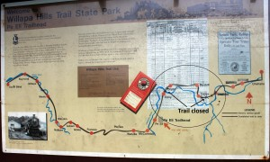 Two closures on eastern section of Willapa Hills Trail are superimposed on this trail sign