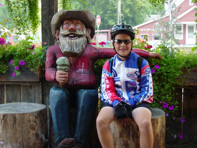 Photo: Young cyclist visits with a local at Methow ice cream shop.