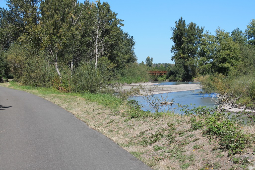 A small bridge crosses the White River on the Sumner Link Trail
