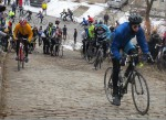 Cyclists begin climb up cobblestones. Photo by Liz Reid, WESA 90.5, Pittsburgh's NPR News Station
