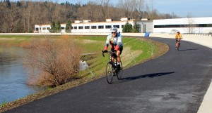 Cyclists already are using smooth pavement on reopened Green River Trail