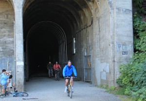 Bicyclists emerge from the tunnel