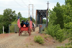 Horse drawn wagon crossing rail-trail bridge near Ellensburg