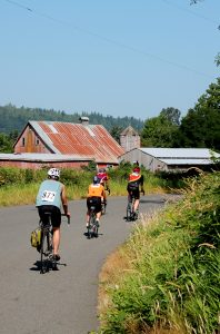 Tour de Peak cyclists pass barns and outbuildings