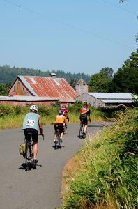 Tour de Peak cyclists pass barns and outbuildings