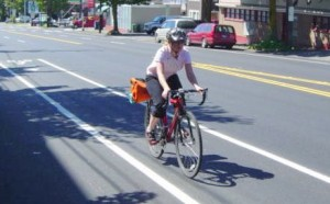 Cyclist rides in Stone Way section with bike lanes